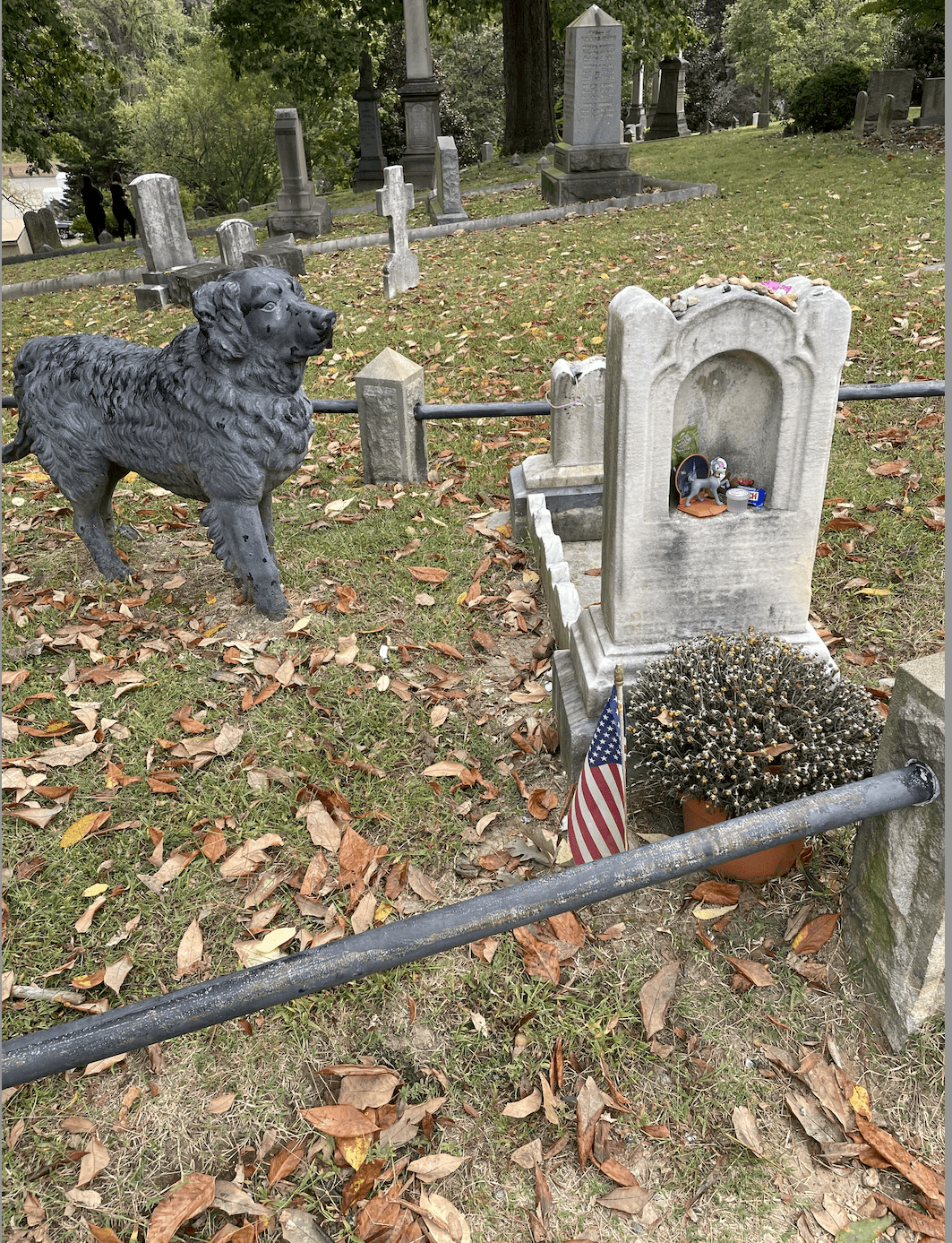 Gravesite of a young girl and iron dog